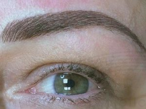 Feathering eyebrows tattoo